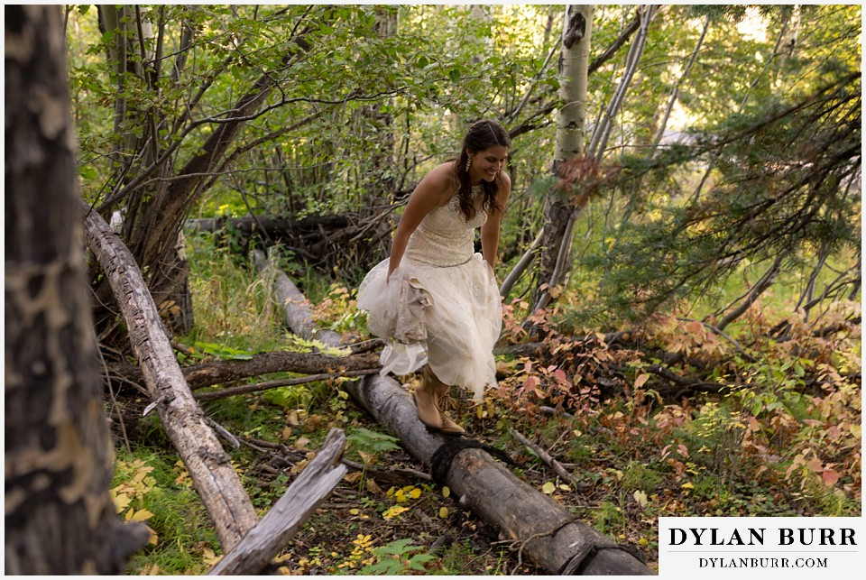 rocky mountain national park elopement wedding bride balancing on log
