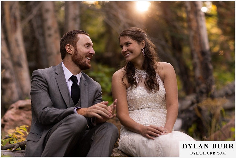 rocky mountain national park elopement wedding couple telling jokes to eachother