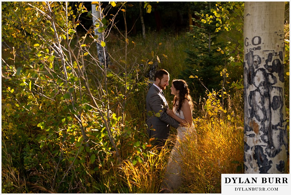 rocky mountain national park elopement wedding couple laughing together in sunlight
