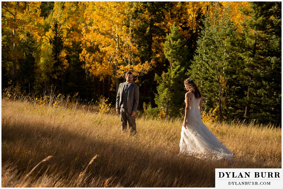 rocky mountain national park elopement wedding walking in the mountains in fall