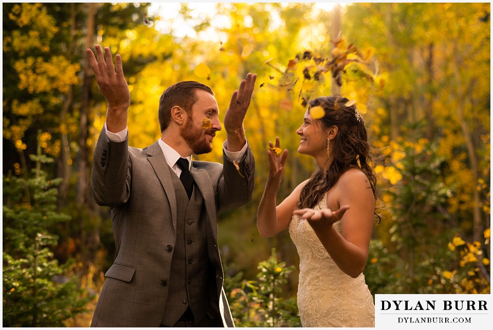 rocky mountain national park elopement wedding throwing up fall colored leaves