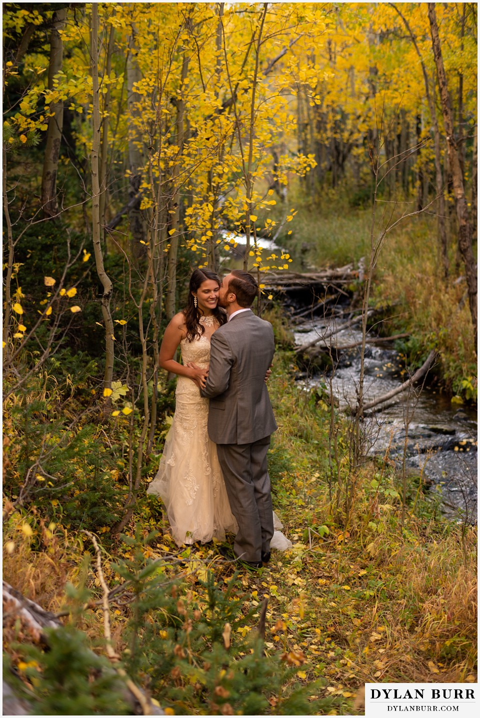 rocky mountain national park elopement wedding bride and groom along stream in fall mountains