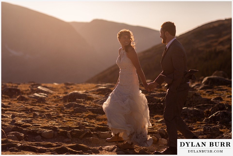 rocky mountain national park elopement wedding bride looking back at groom in alpine tundra