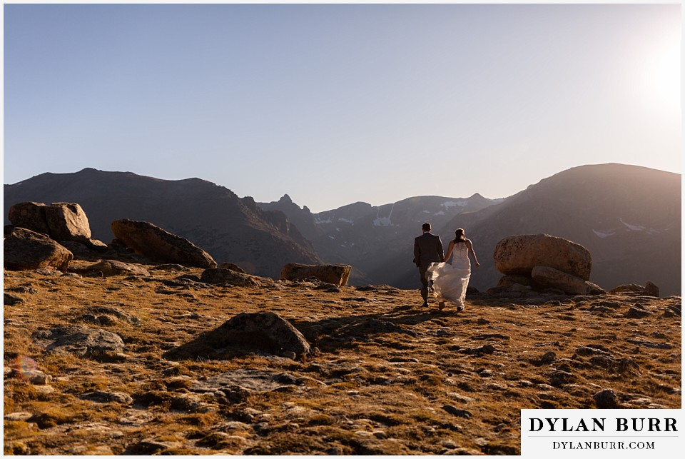rocky mountain national park elopement wedding couple walking out to the mountain ledge