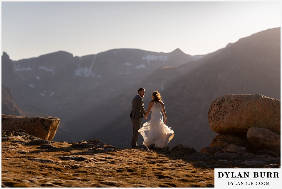 rocky mountain national park elopement wedding couple standing together in the mountain wind