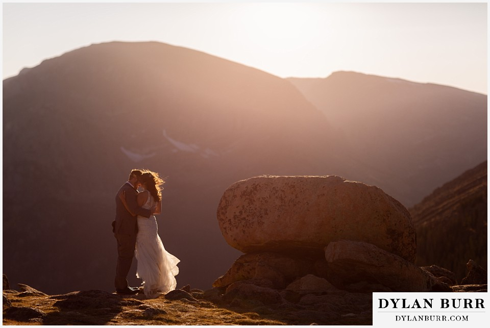 rocky mountain national park elopement wedding kissing in sunset glow