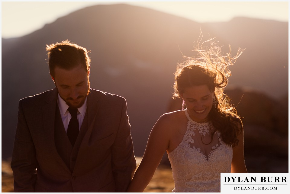 rocky mountain national park elopement wedding couple walking together in wind