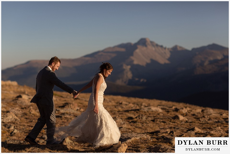 rocky mountain national park elopement wedding couple walking on rocks on mountain top