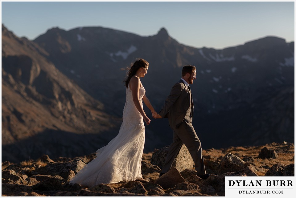 rocky mountain national park elopement wedding couple walking in snow capped mountain