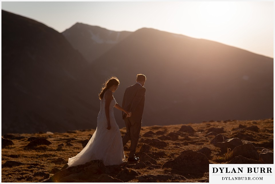 rocky mountain national park elopement wedding couple walking out into the sunset