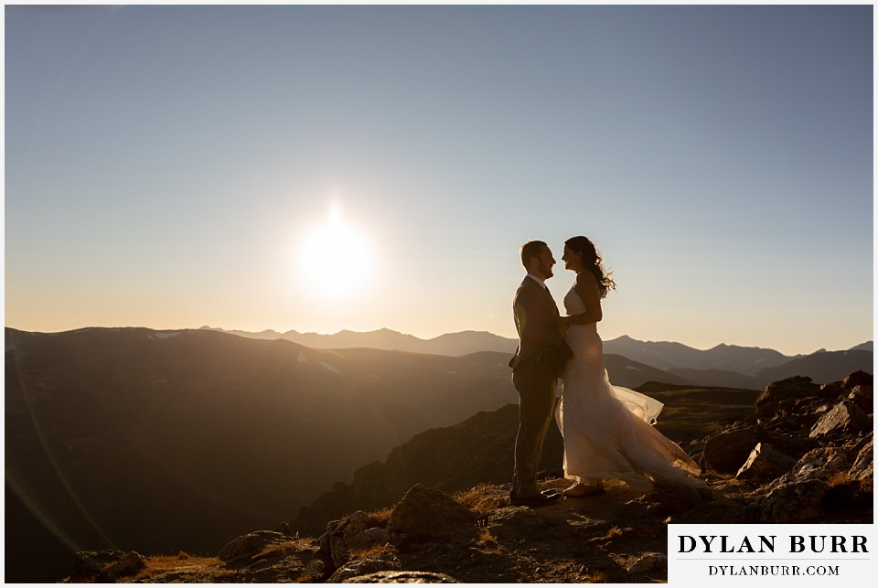 rocky mountain national park elopement wedding couple in sunlit silhouette