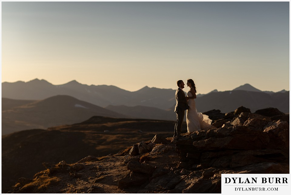 rocky mountain national park elopement wedding couple on mountain top at sunset