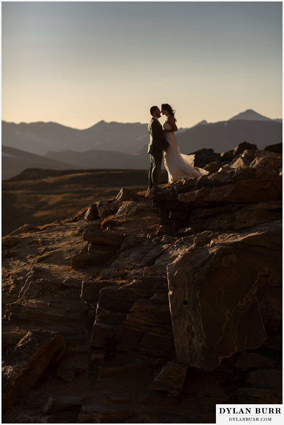 rocky mountain national park elopement wedding couple on rocky mountain top