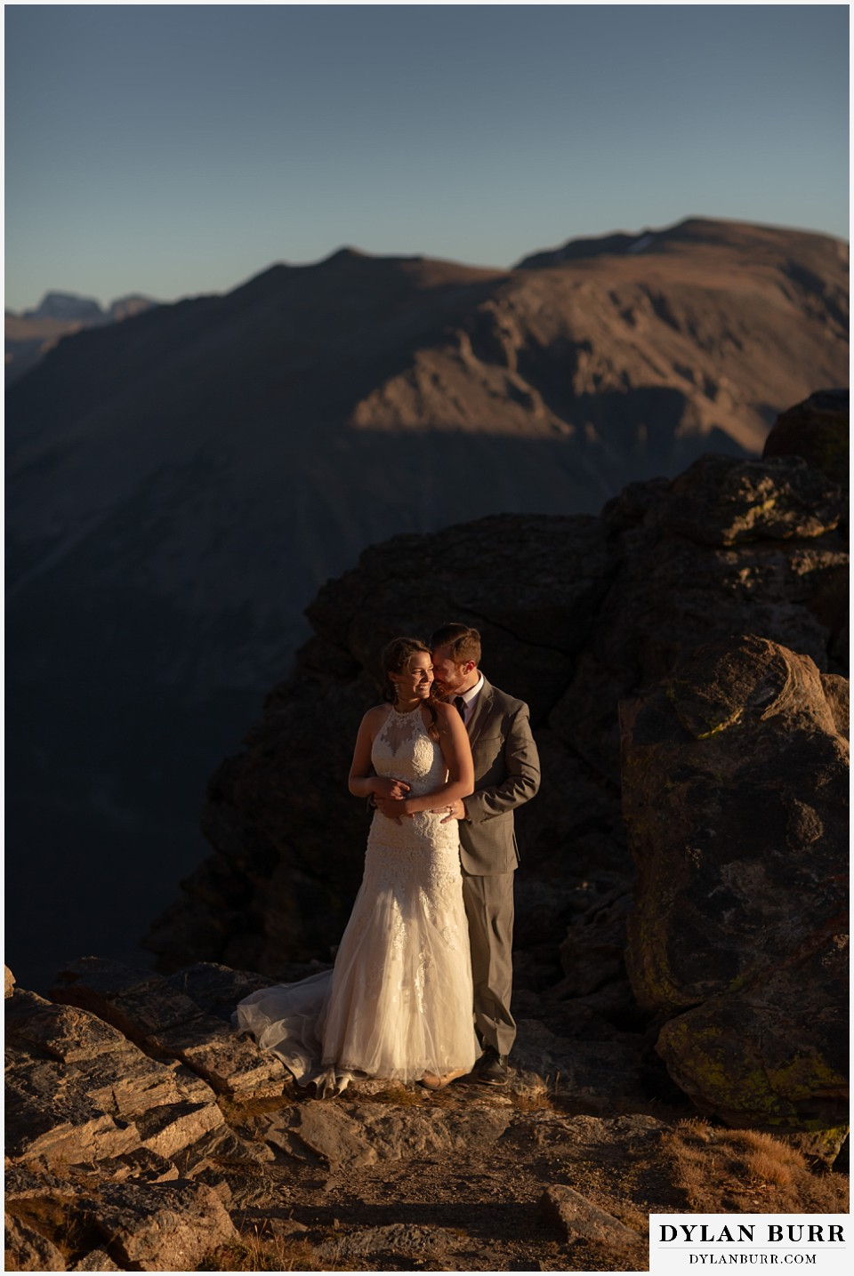 rocky mountain national park elopement wedding newlyweds nuzzling in close at sunset