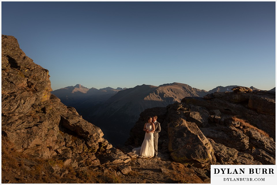 rocky mountain national park elopement wedding couple together in sunlight with long peak in the background