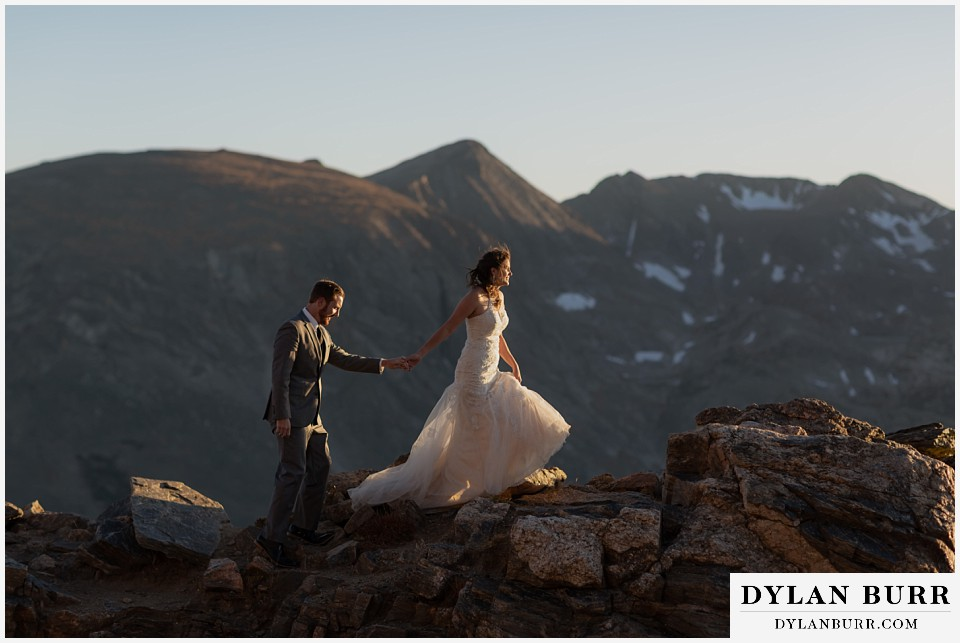 rocky mountain national park elopement wedding bride and groom hiking together