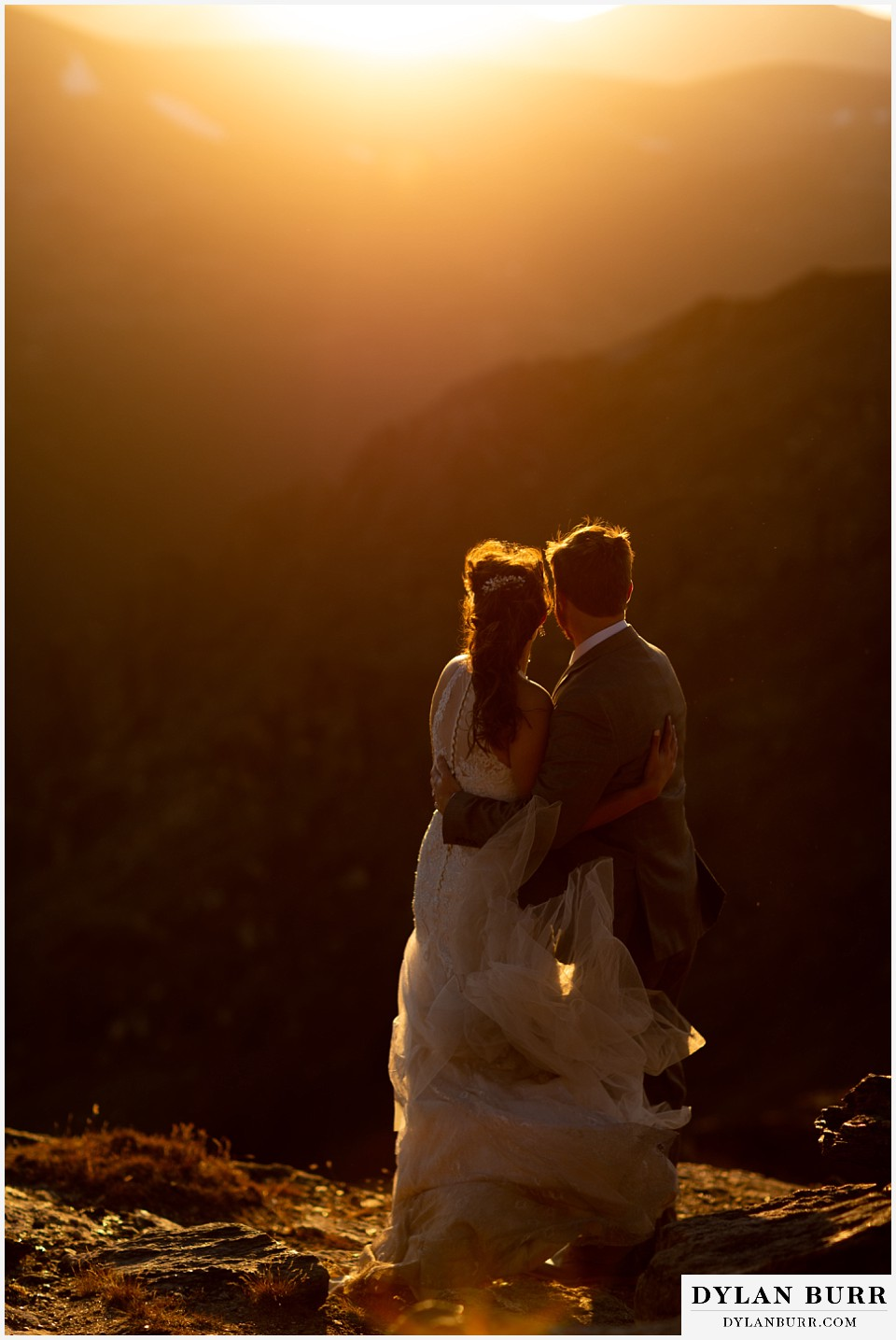 rocky mountain national park elopement wedding bride and groom holding each other in sunlight