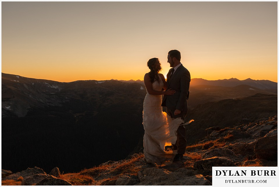 rocky mountain national park elopement wedding bride and groom at sunset surrounded by light