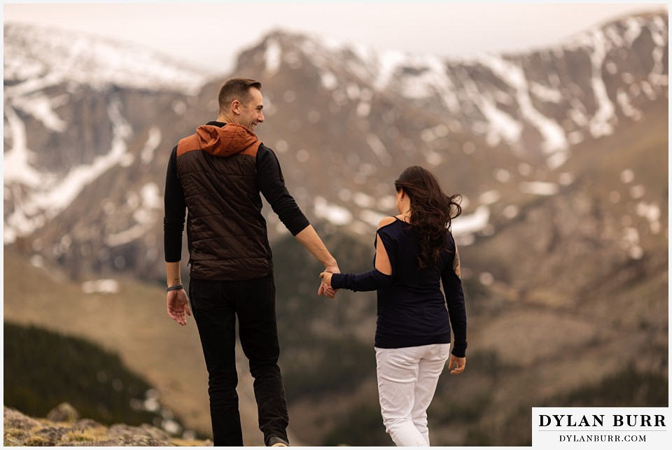 rocky mountain engagement session in colorado huge snow capped mountains