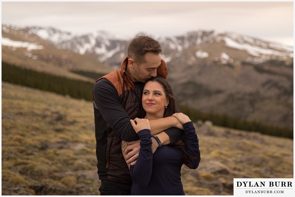 rocky mountain engagement session in colorado high mountain hugs