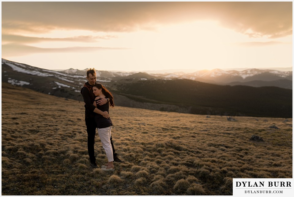 rocky mountain engagement session in colorado huge mountain view at sunset