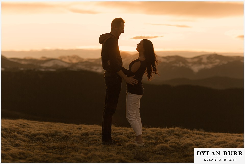 rocky mountain engagement session in colorado sunset silhouette