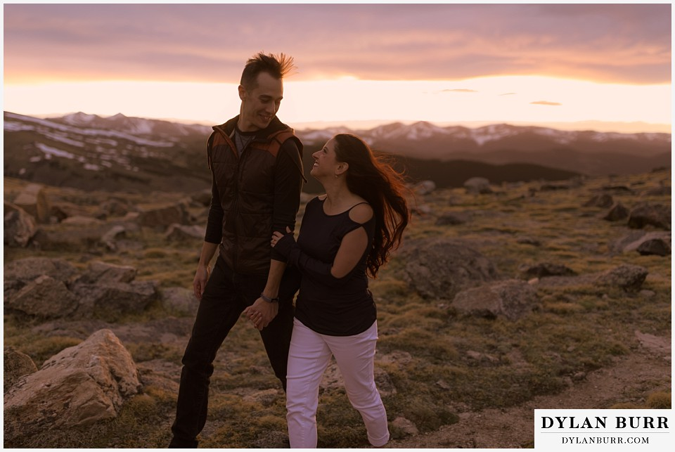 rocky mountain engagement session in colorado on top of the mountain at sunset