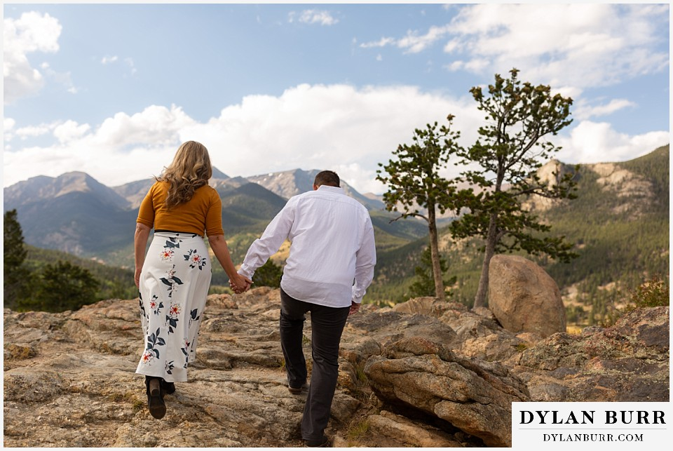 rocky mountain national park elopement wedding bride and groom hiking up hill