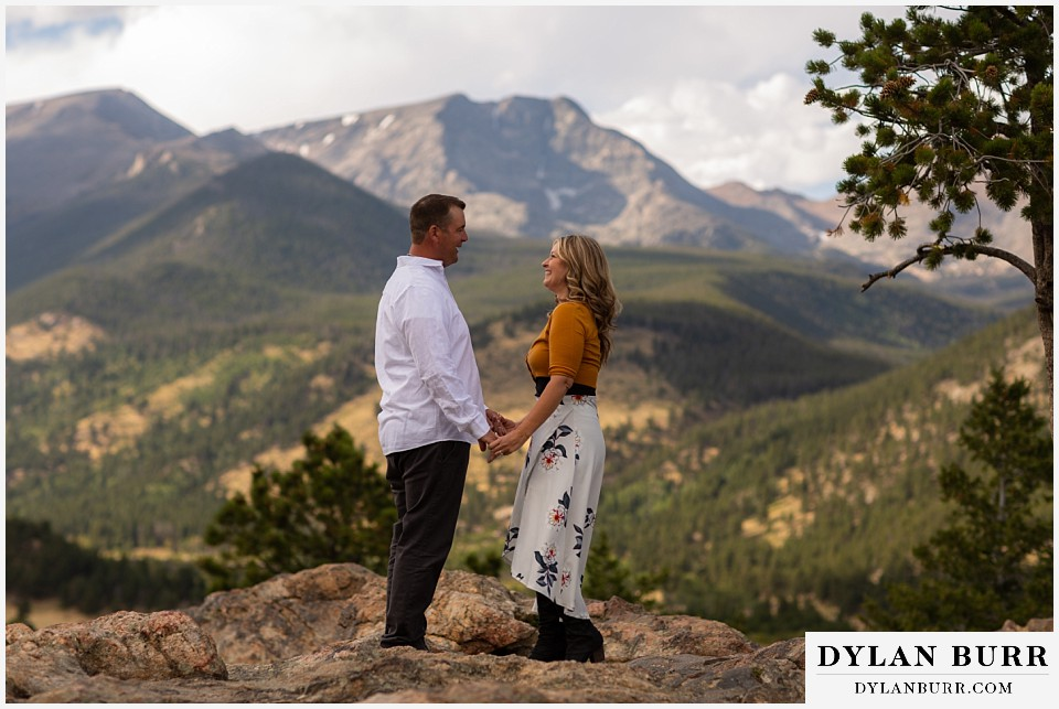 rocky mountain national park elopement wedding bride and groom holding hands