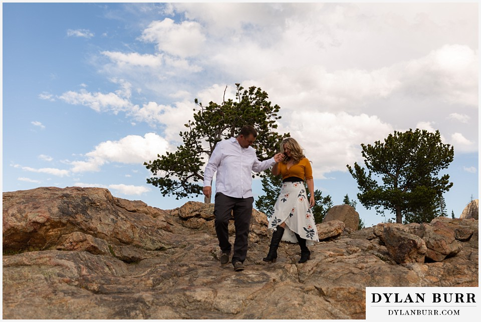 rocky mountain national park elopement wedding bride and groom walking downhill