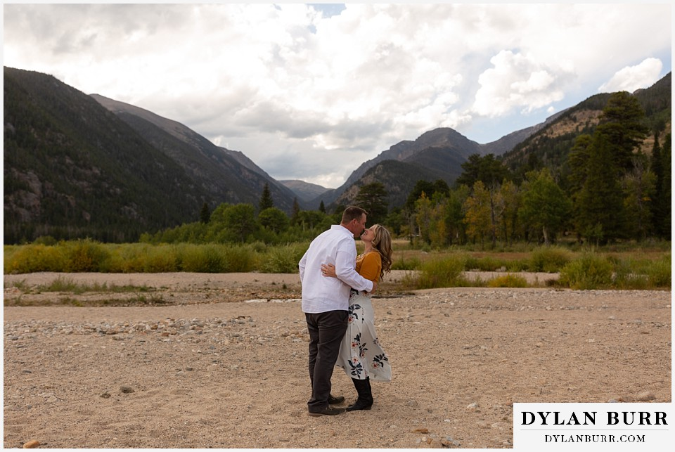 rocky mountain national park elopement wedding bride and groom kissing in mountain valley