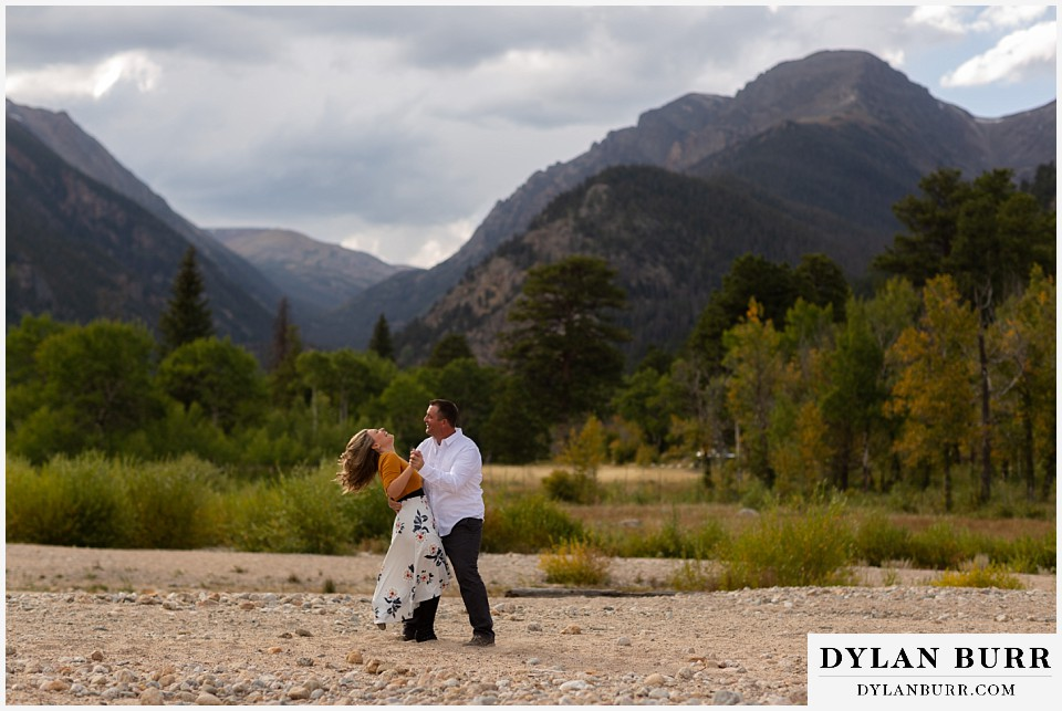 rocky mountain national park elopement wedding bride laughing as her groom picks her up