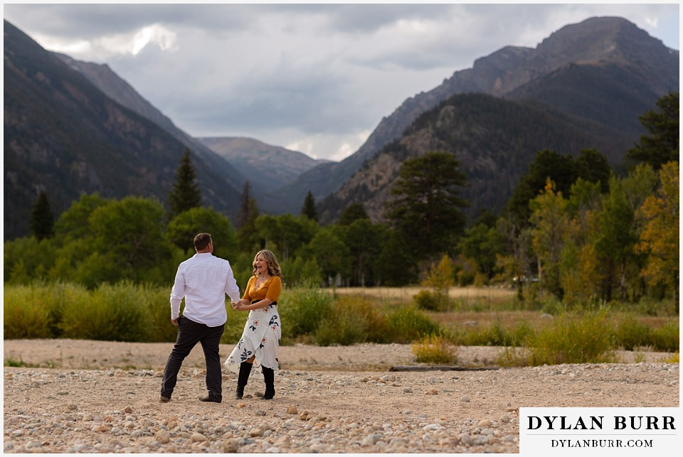 rocky mountain national park elopement wedding bride and groom laughing together in mountain valley