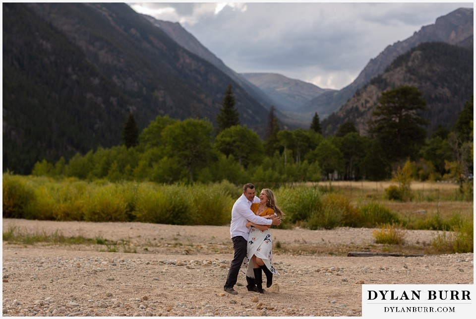 rocky mountain national park elopement wedding groom brings bride in close