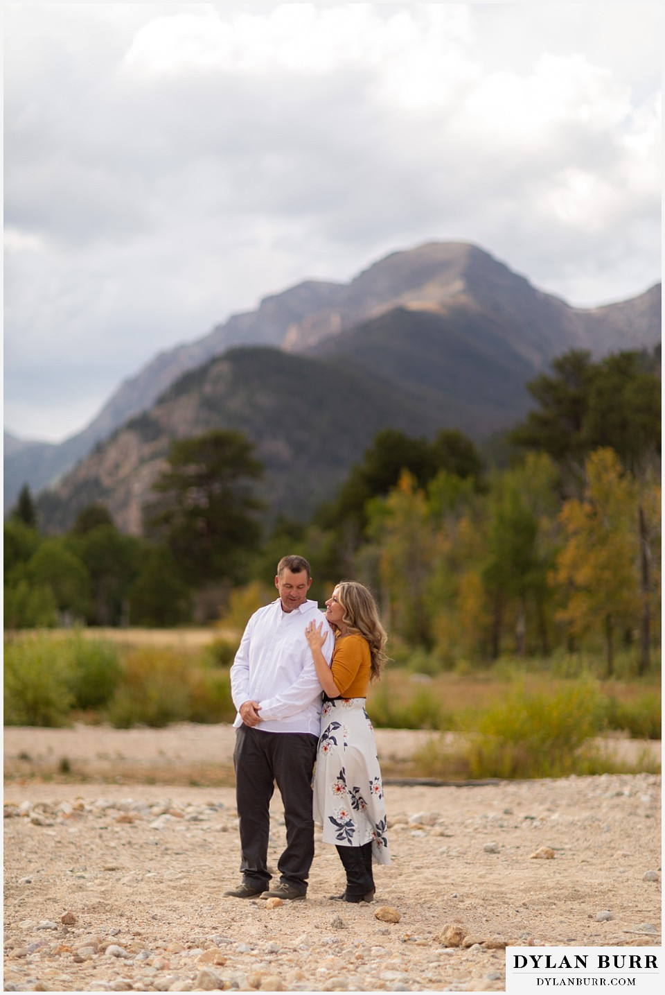 rocky mountain national park elopement wedding bride getting in close to groom with mountain in background