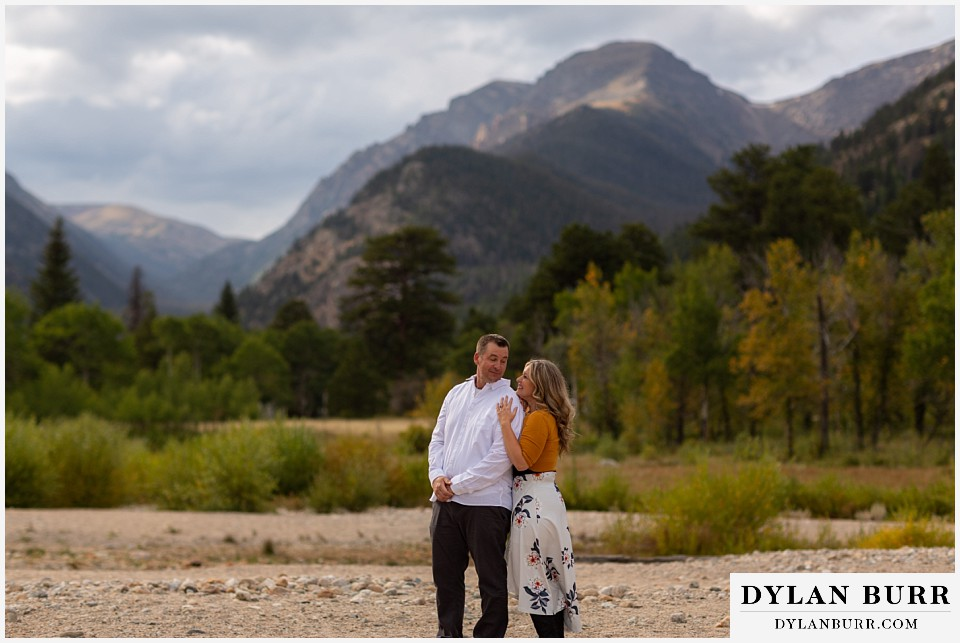 rocky mountain national park elopement wedding bride and groom together near river
