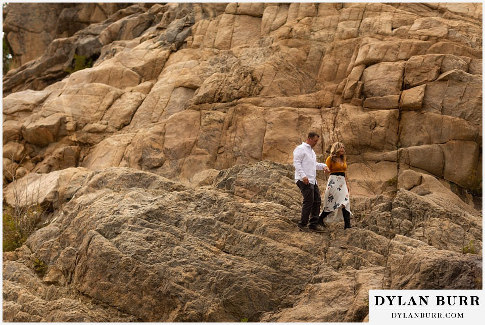 rocky mountain national park elopement wedding bride and groom walking across mountain ledge