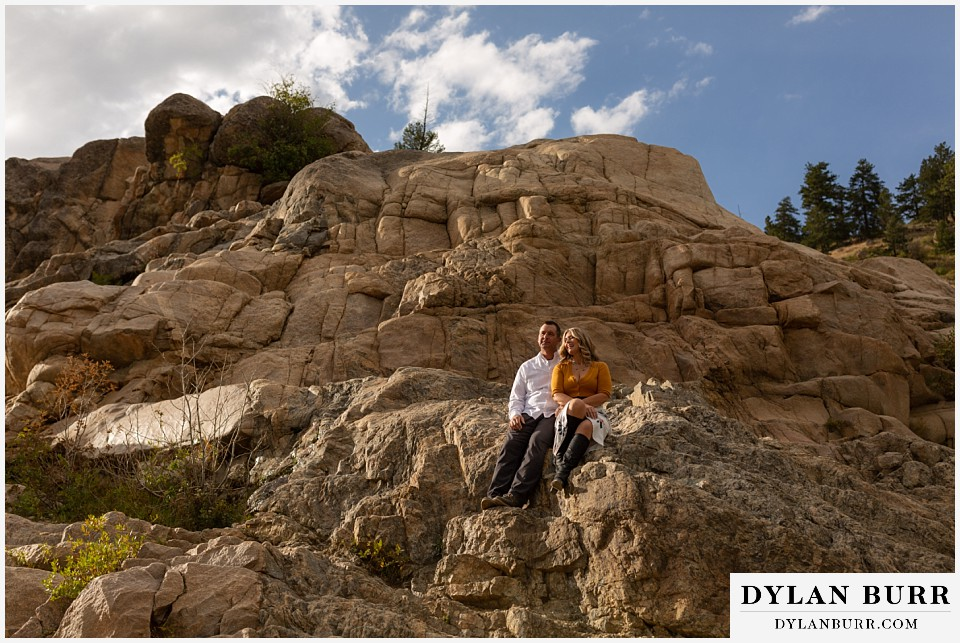 rocky mountain national park elopement wedding couple getting some sun on rocks