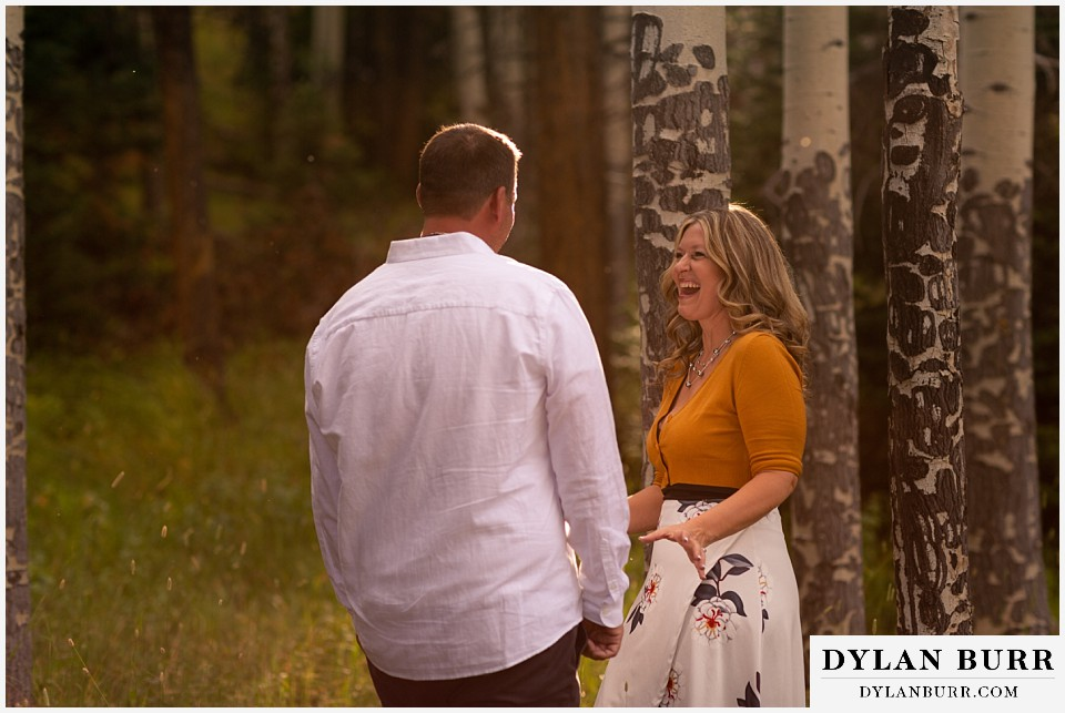 rocky mountain national park elopement wedding newlywed couple playing in trees and sunlight