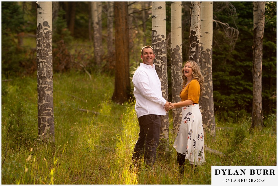 rocky mountain national park elopement wedding couple looking back at photographer laughing