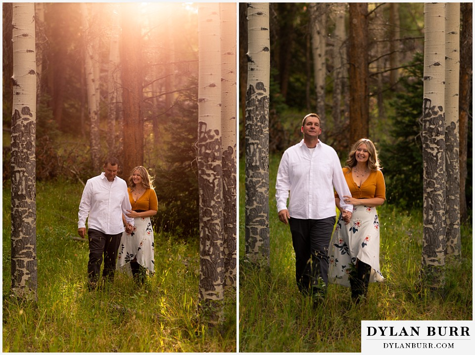 rocky mountain national park elopement wedding bride and groom walking in sunlight in aspen trees