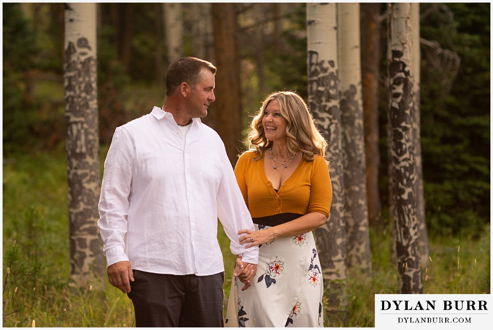 rocky mountain national park elopement wedding brides hair glowing while walking with groom