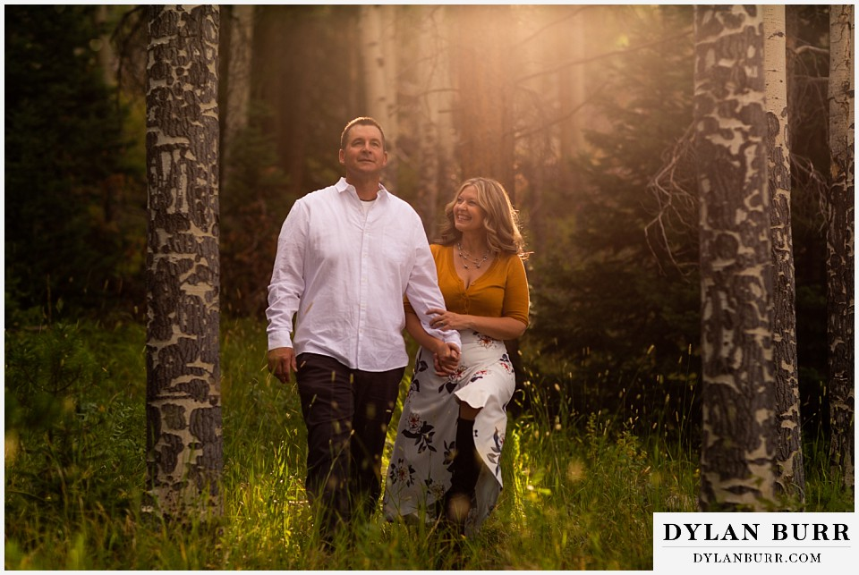 rocky mountain national park elopement wedding happy newlyweds in sunset forest