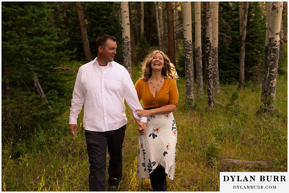 rocky mountain national park elopement wedding couple laughing together in forest