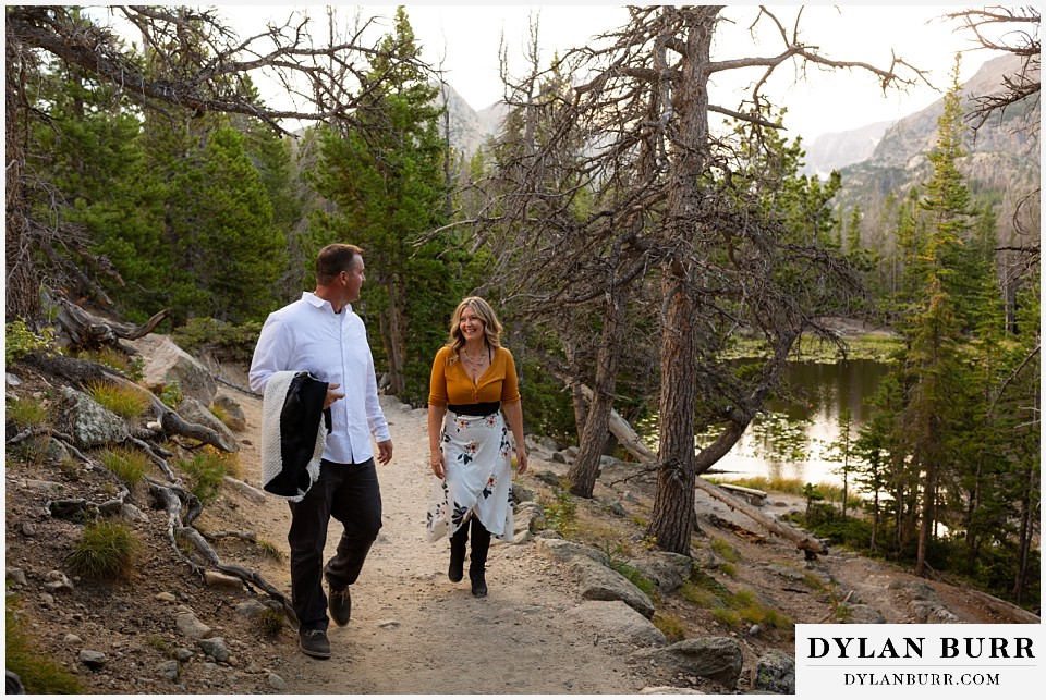 rocky mountain national park elopement wedding couple walking in forest together