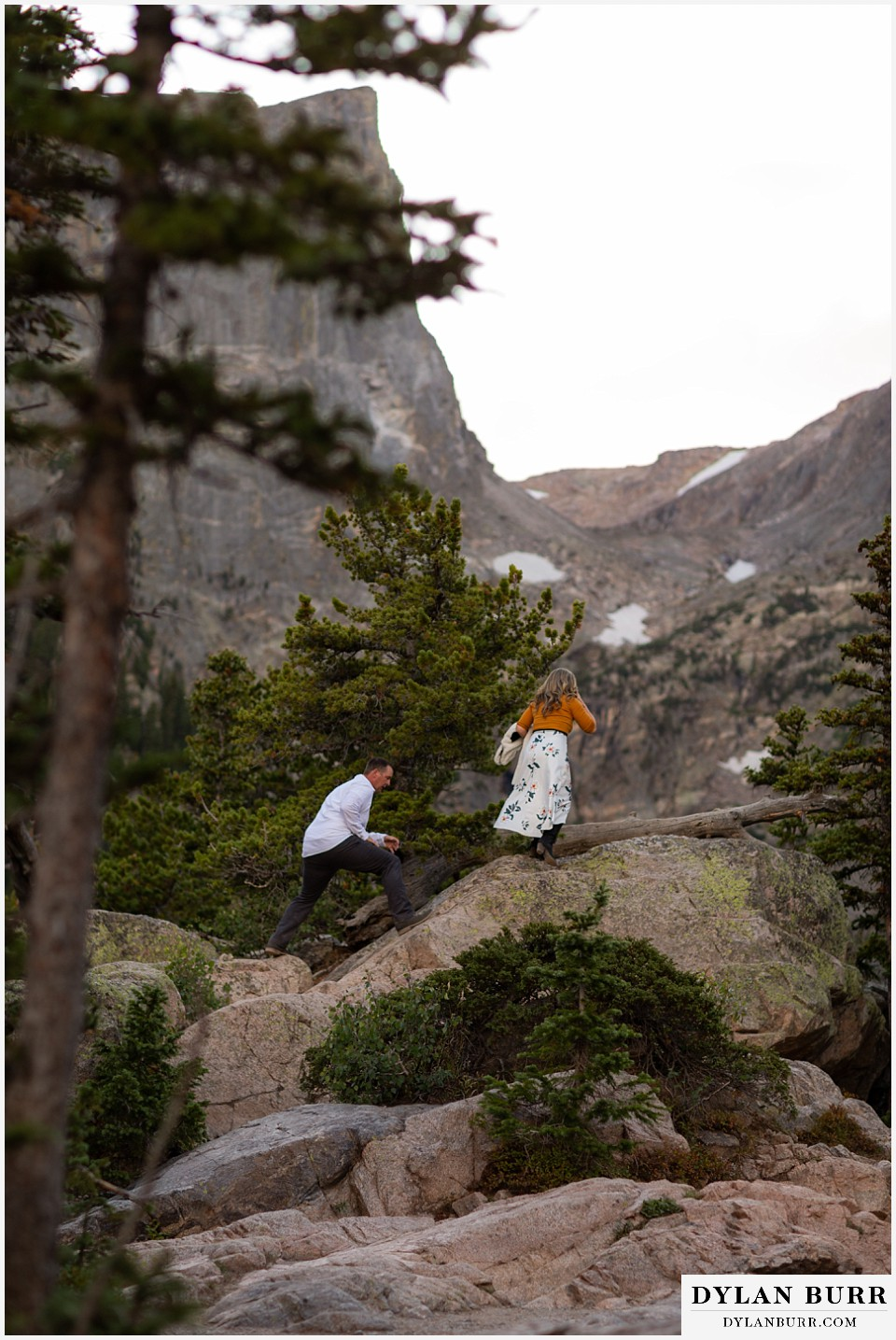 rocky mountain national park elopement wedding bride and groom hiking in snow capped mountains
