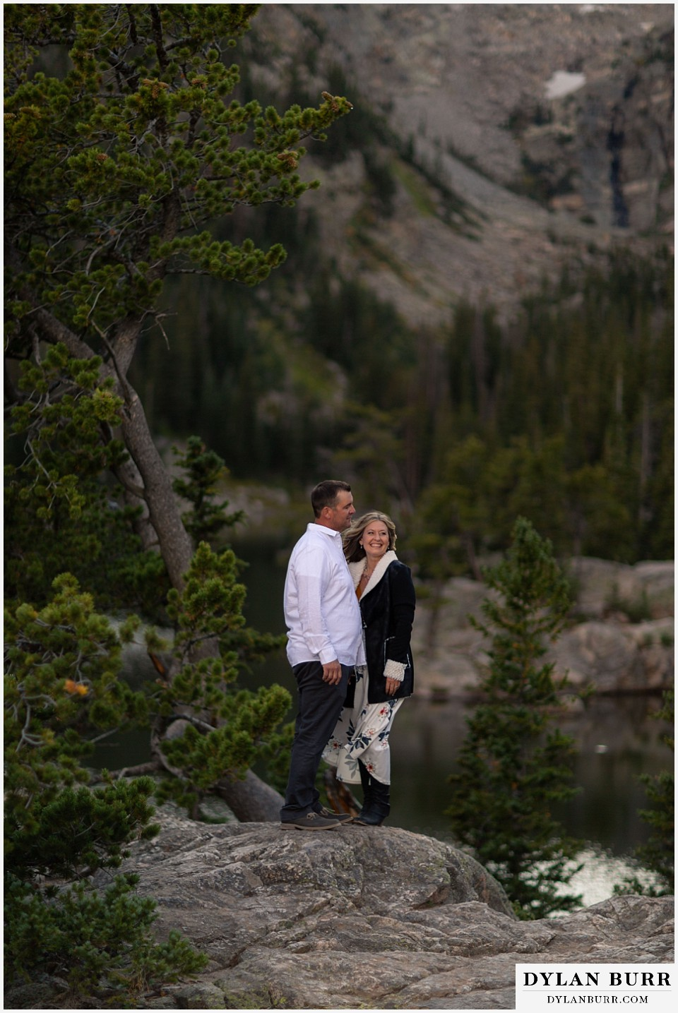 rocky mountain national park elopement wedding bride and groom laughing in mountains
