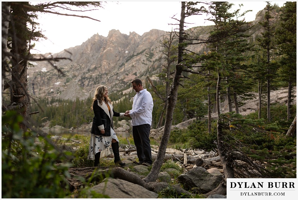 rocky mountain national park elopement wedding bride and groom hiking in high mountains