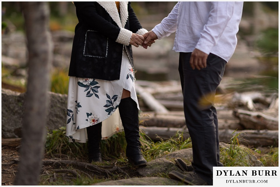 rocky mountain national park elopement wedding couple holding hands in mountains