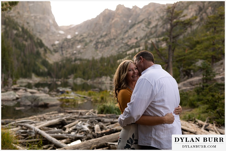 rocky mountain national park elopement wedding couple hugging in mountains